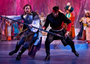 Pictured: In the colorful kingdom of Pentapolis, Pericles (Jon Barker) battles a knight (Jordan Laroya) during Princess Thaisa's birthday tournament. Photo:  ©Jerry Dalia, The Shakespeare Theatre of New Jersey.