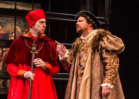 King Henry (right, David Foubert) consults with his trusted advisor, Cardinal Wolsey (Philip Goodwin). Photo: © Jerry Dalia,  The Shakespeare Theatre of New Jersey